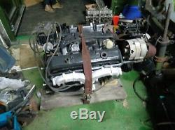 Chevy Chevrolet complete 305 v8 engine with 4bl inlet manifold sbc small block